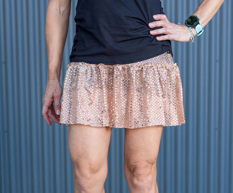 model wearing rose gold sparkle skirt