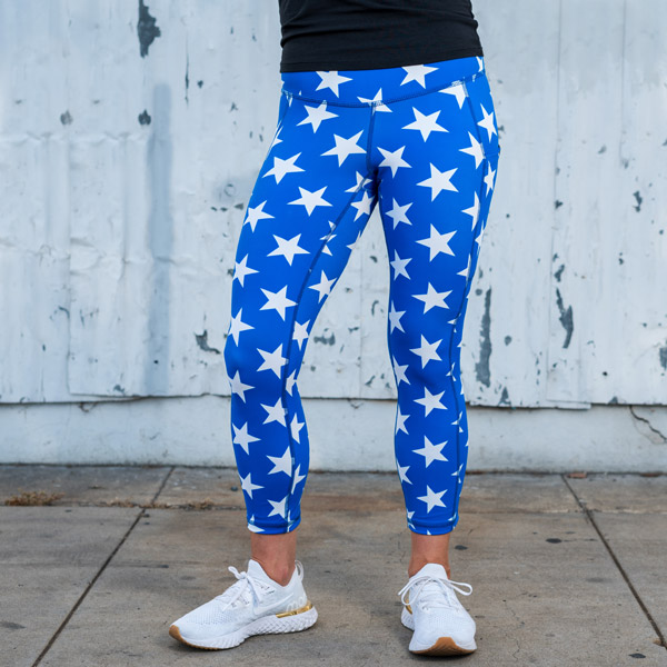 model wearing star running leggings