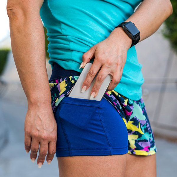 model wearing running shorts with phone pocket featuring shark fabric