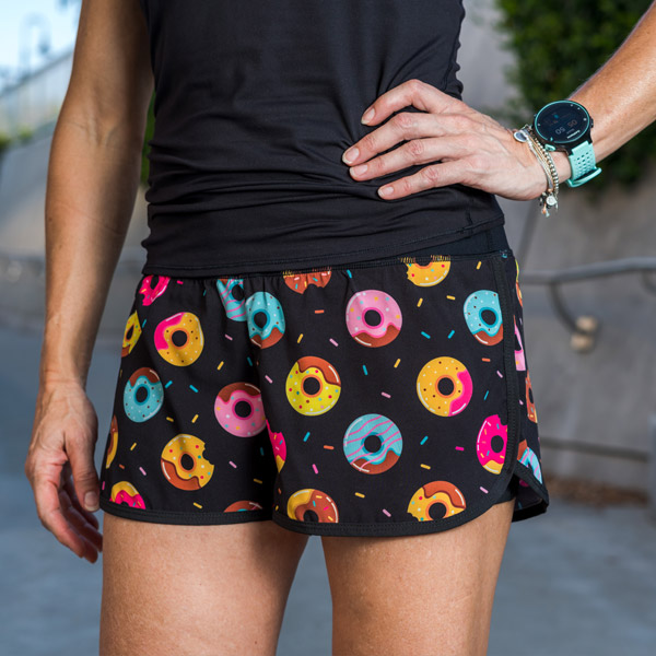 model wearing running shorts with pockets with donuts