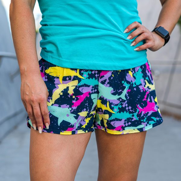 model wearing Shark running shorts with pockets