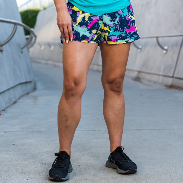 model wearing running shorts with pockets featuring shark fabric