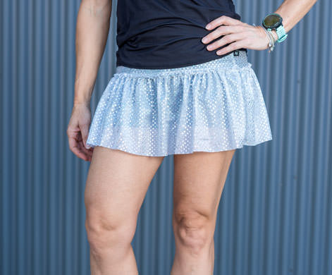 model wearing silver holographic sparkle skirt